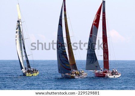 ALICANTE, SPAIN - OCTOBER 2: Volvo Open 65 embarcations in regatta race, training day for the Open 65 sailboat class in Alicante bay, on october 2, 2014 in Alicante. - stock photo