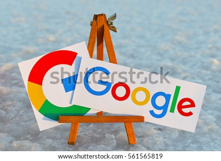 Alicante, Spain - September 18, 2016: Google icons printed on paper and placed on wooden easel. Google it is the largest Internet search engine, owned of Google.