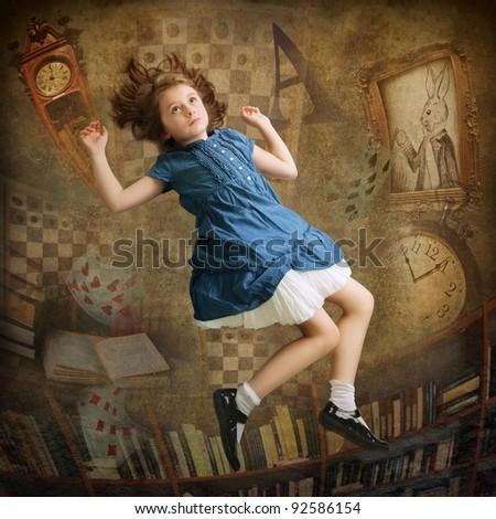 Alice falling down the rabbit hole - stock photo