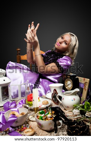 alice in wonderland drink look at bottle of poison - stock photo