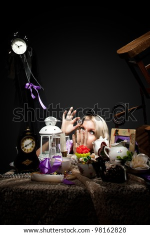 alice in wonderland look at bottle of poison - stock photo
