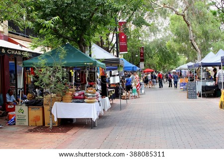 ALICE SPRINGS, AUSTRALIA - December 6. People are shopping at the weekly sunday market with handicrafts, food and drinks on December 6, 2015 in Alice Springs. - stock photo