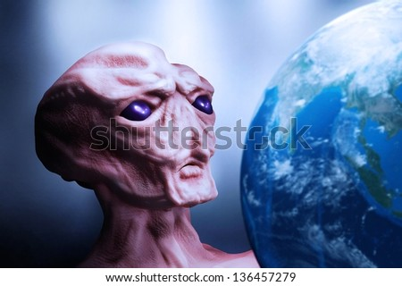 alien and planet Earth - stock photo