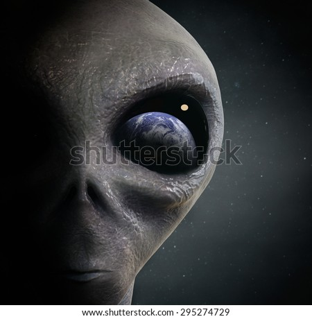 alien looking at the earth - stock photo