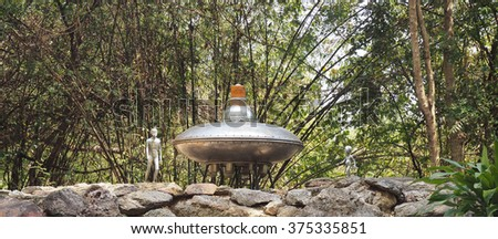 Aliens and spaceship in a forest - stock photo