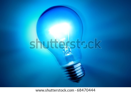 alight bulb over blue background - stock photo