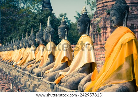 Aligned Buddha Statues at Wat Yai Chaimongkol Ayutthaya Bangkok Thailand - stock photo