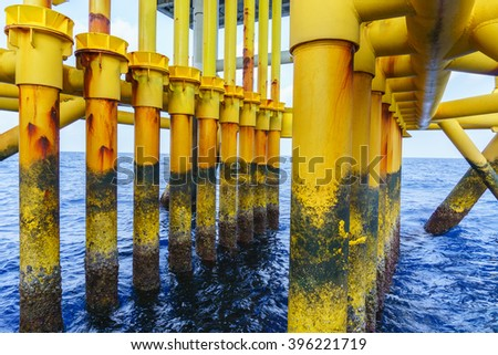 Aligned Oil and Gas Production slots on Offshore wellhead remote platform, Energy and petroleum industry. - stock photo