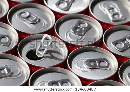 Aligned soda cans with one opened. Top view. - stock photo