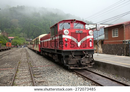 ALISHAN, TAIWAN - APRIL 13 : Alishan Forest Railway on April 13, 2015, It's an 86 km running up to mountain of Alishan. Tourist attraction with 50 tunnels and over 77 wooden bridges on the railway.