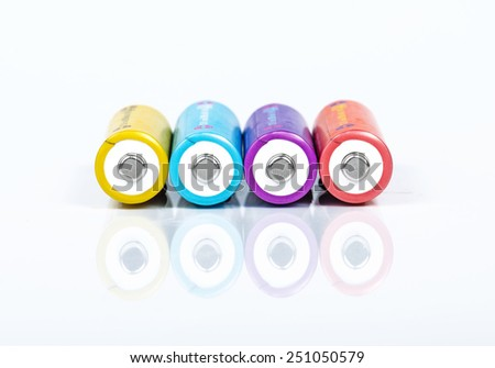 Alkaline batteries on white background - stock photo