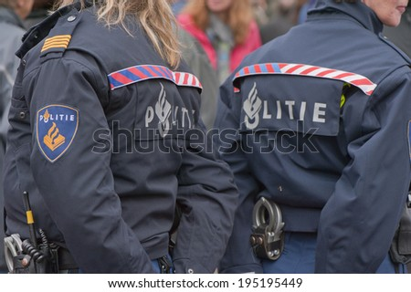 ALKMAAR, NETHERLANDS-CIRCA MAY 2014: Police on duty during traditional Friday Cheese Market