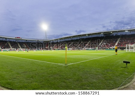 ALKMAAR, NETHERLANDS - OCT 03: Interior view of the full AFAS Stadion on October 03, 2013 in Alkmaar, Netherlands. AFAS Stadion is the home base of the football team AZ Alkmaar.