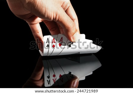 All aces with black background - stock photo