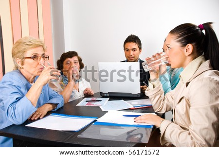 All business people drinking  water at meeting and making a break - stock photo