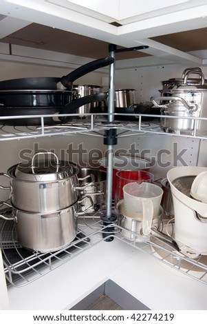 All cooking Pans in the kitchen cabinet