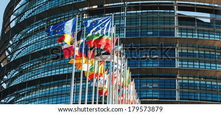 All EU members flags in front of the European Parliament in Strasbourg, France - stock photo
