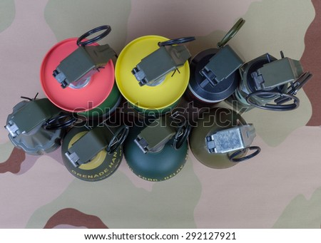 All explosives, weapon army,standard time fuze, hand grenade on camouflage background, top view - stock photo