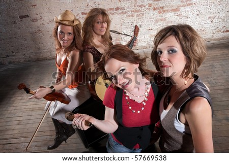 All-Female band members gathering before a performance - stock photo