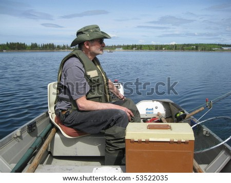 All geared up and waiting for the fish to bite - stock photo