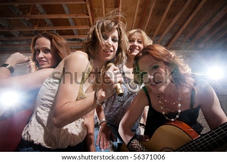 All girl band performing in stylish clothing - stock photo