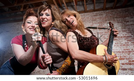 All girl trio performing in stylish clothing - stock photo