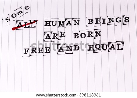 all human beings are born free and equal text on paper in retro style - stock photo