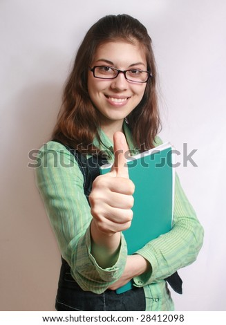 All is excellent. Portrait of the girl with the hand extended forward and lifted upwards thumb. - stock photo