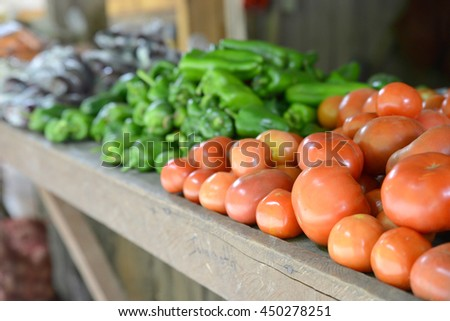 All kinds of organic vegetables on a rural market's table - stock photo