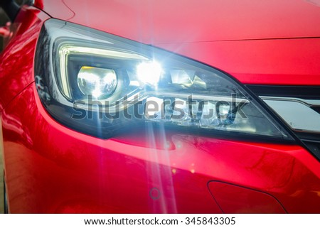 All LED adaptive headlight of a modern car. Headlight consists of 16 individual matrix LED units that can be switched on, off or dimmed, depending on driving conditions. - stock photo