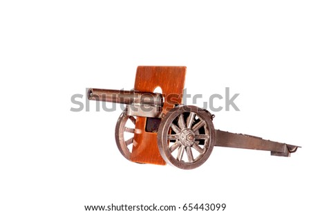 All-metal vintage toy cannon, white isolation. - stock photo