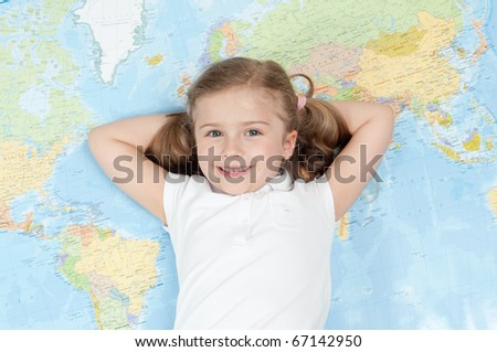 All my world - happy little girl on map background