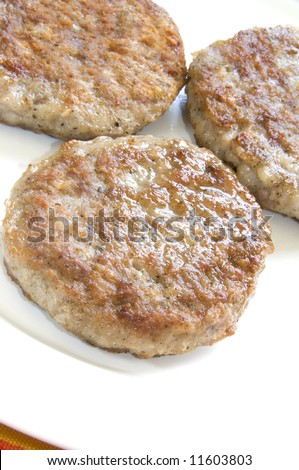 all natural cooked pork sausage patties breakfast - stock photo