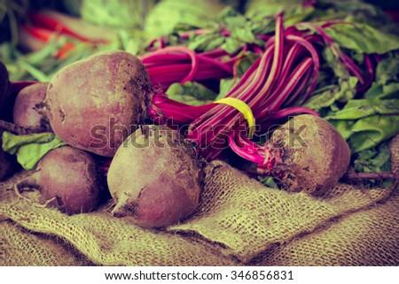 All natural organic farmers market beats on hemp cloth - stock photo