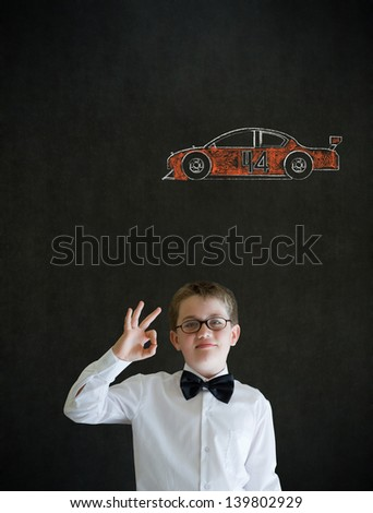 All ok or okay sign boy dressed up as business man with American racing fan car on blackboard background - stock photo