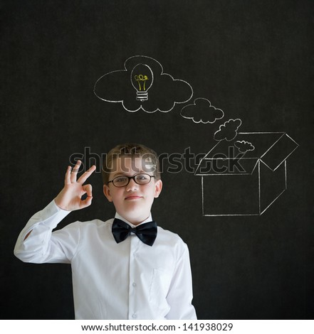 All ok or okay sign boy dressed up as business man with chalk thinking out the box concept  on blackboard background - stock photo