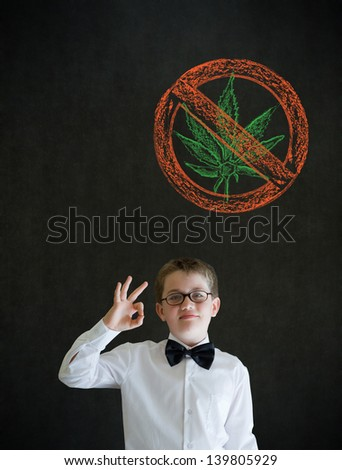 All ok or okay sign boy dressed up as business man with no weed marijuana on blackboard background - stock photo