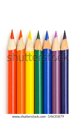 All rainbow colors in sharpened drawing pencils on white background - stock photo