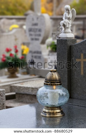 All Saints' Day in Poland. Candle on a Christian grave. - stock photo