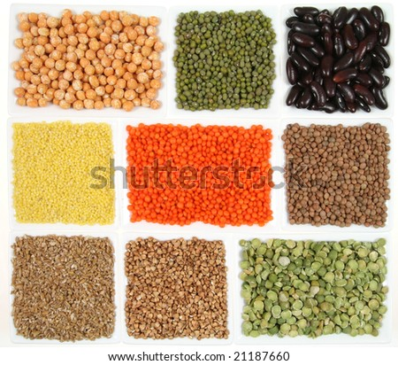 All sorts of beans and cereals sorted in white ceramic containers. Decorative and colorful food abstract. - stock photo