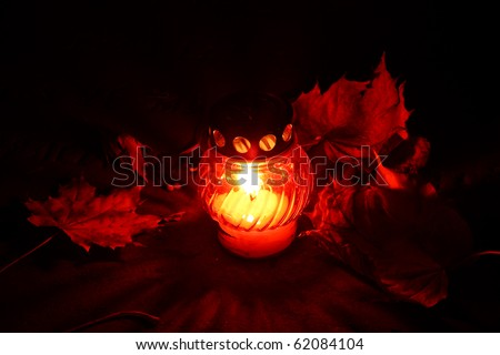 All Souls'Day at the cementary - candle close up - stock photo