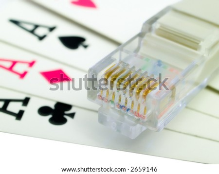 All the aces and a network cable representing online gambling. - stock photo