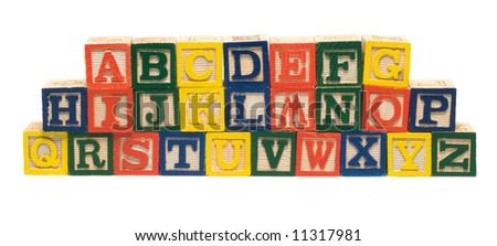 All the letters of the alphabet piled using wooden blocks - stock photo