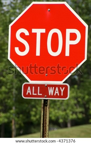All way stop sign to let drivers know that everyone at that intersection has to stop