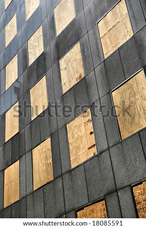All windows boarded up with wooden panels after Hurricane Ike(Release Information: Editorial Use Only. Use of this image in advertising or for promotional purposes is prohibited.) - stock photo