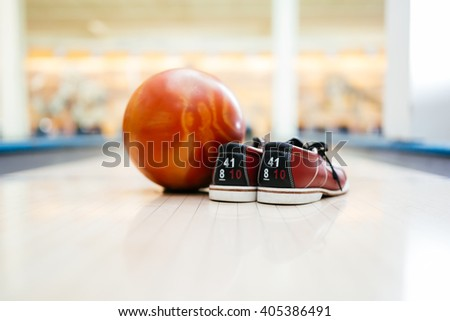 All you need for bowling is a pair of shoes and a ball - stock photo