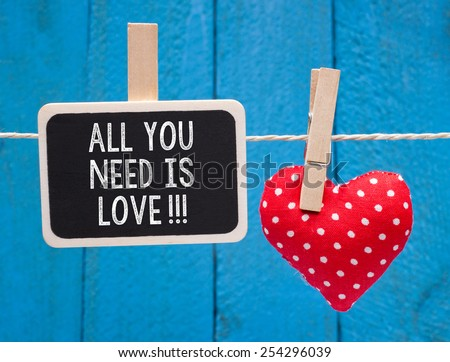 All you need is Love - blackboard with text and red heart - stock photo