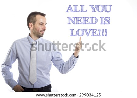 All you need is love!!! Young businessman with small beard touching text