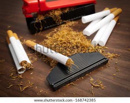All you need to produce cigarettes at home. - stock photo