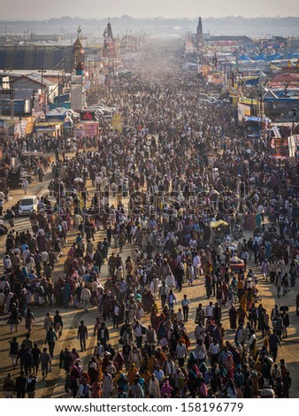 Allahabad, India - February 09, 2013: Thousands of Hindu devotees at Kumbh Mela festival 2013 in Allahabad, India, the world's largest religious gathering. - stock photo